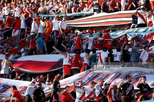 Fans of River Plate cheer for their team during a match between River Plate and Atletico de Tucuman as part of Superliga 2017/18 at Monumental...