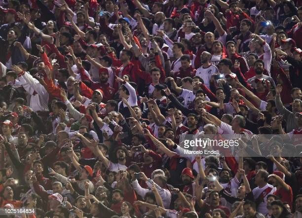 Fans of River Plate cheer for their team during a round of sixteen second leg match between River Plate and Racing Club as part of Copa CONMEBOL...