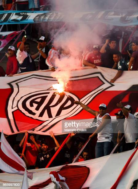 Fans of River Plate cheer for their team prior a first leg match between River Plate and Lanus as part of semifinals of Copa CONMEBOL Libertadores...