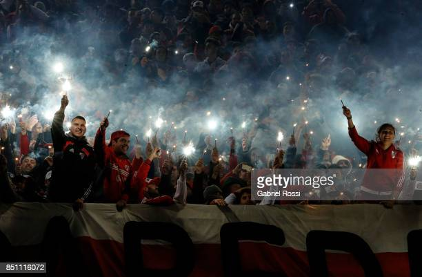 Fans of River Plate cheer their team during a second leg match between River Plate and Wilstermann as part of the quarter finals of Copa CONMEBOL...
