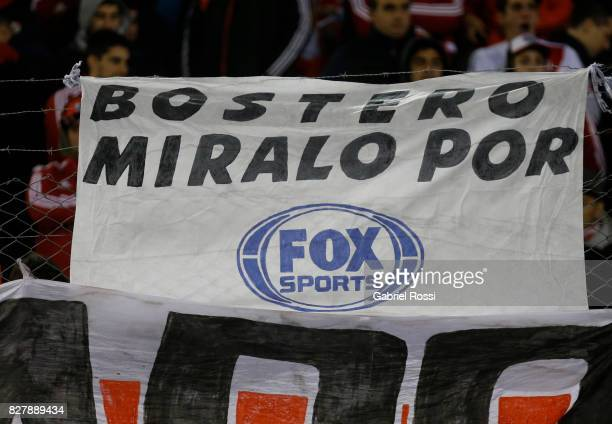 Fans of River Plate display a banner before a second leg match between River Plate and Guarani as part of round of 16 of Copa CONMEBOL Libertadores...