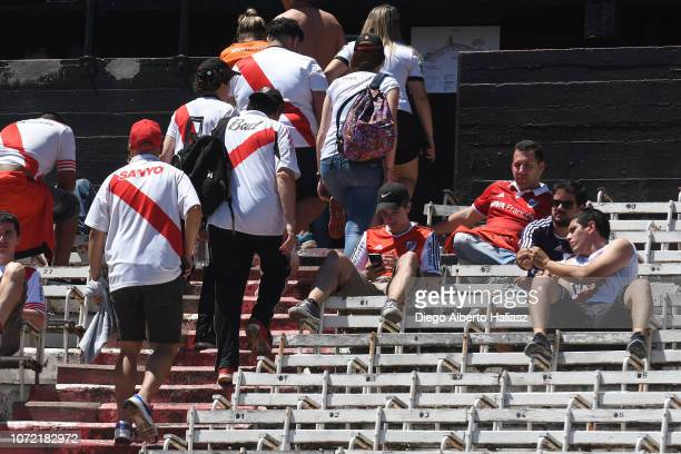 Fans of River Plate leave the stadium after the match was postponed for the second leg of the final of Copa CONMEBOL Libertadores 2018 between River...