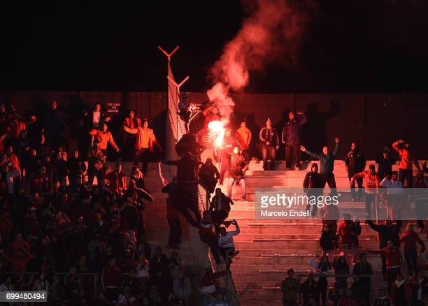 Fans of River Plate light flares to cheer their team during a match between River Plate and Aldosivi as part of Torneo Primera Division 2016/17 at...