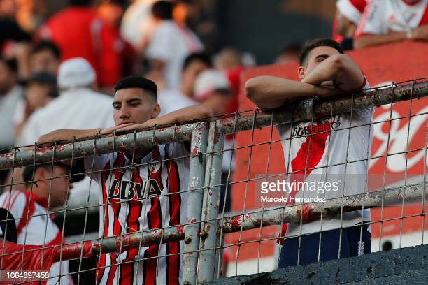 Fans of River Plate react after the match is suspended for the second leg final match of Copa CONMEBOL Libertadores 2018 between River Plate and Boca...
