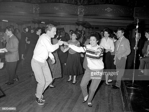 Fans of Rock n roll singer Bill Haley dance to his music as he performs with his band The Comets on stage at Hammersmith February 1957