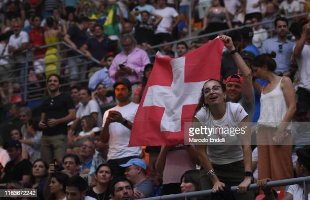 Fans of Roger Federer celebrates with a flag of Switzerland in the stands during an exhibition game between Alexander Zverev and Roger Federer at...