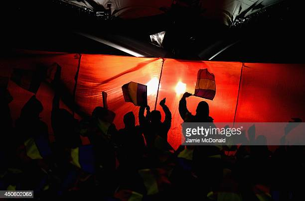 Fans of Romania show their colours during the FIFA 2014 World Cup Qualifier Play-off Second Leg match between Romania and Greece at the National...