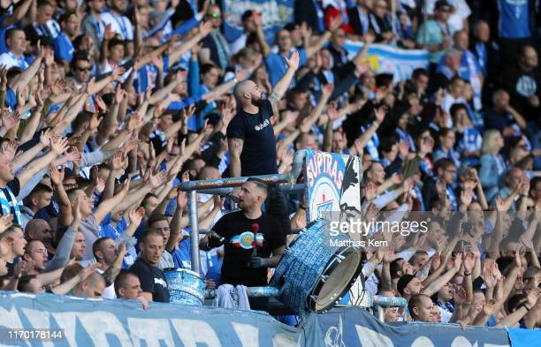 Fans of Rostock are pictured during the 3. Liga match between FC Hansa Rostock and FSV Zwickau at Ostseestadion on September 22, 2019 in Rostock,...