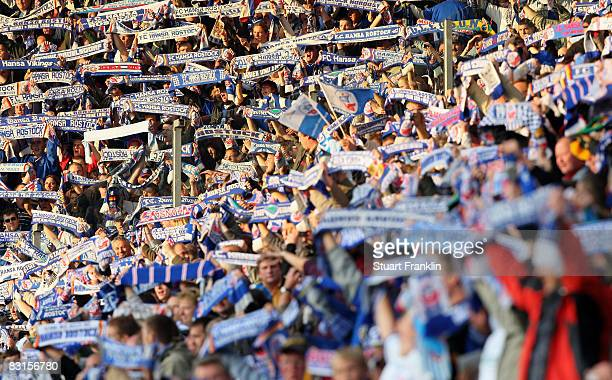 Fans of Rostock hold their scarves during the Second Bundesliga match between FC Hansa Rostock and FC St. Pauli at the DKB Arena on September 26,...