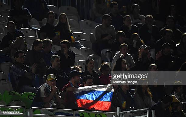 Fans of Russia holding a flag watch the Men's Beach Volleyball Quarterfinal match on Day 10 of the Rio 2016 Olympic Games at the Beach Volleyball...