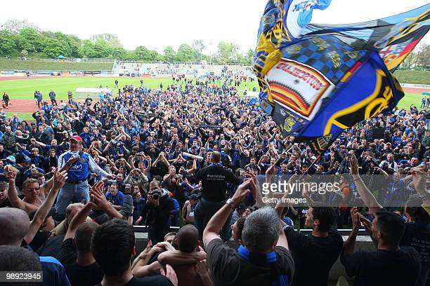 Fans of Saarbruecken celebrate during the Regionalliga match between Bonner SC and 1.FC Saarbruecken at the ARENA stadium on May 8, 2010 in Bonn,...
