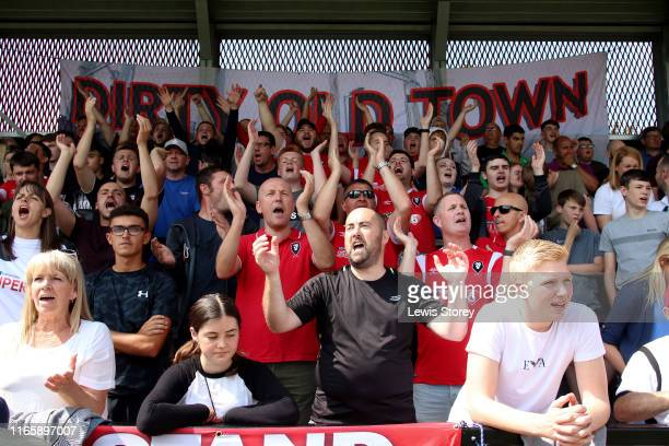 Fans of Salford CIty show their support during the Sky Bet League Two match between Salford City and Stevenage at Moor Lane on August 03, 2019 in...