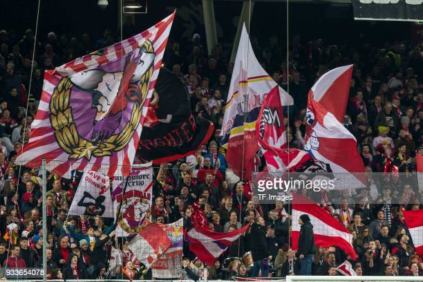 Fans of Salzburg are seen during UEFA Europa League Round of 16 second leg match between FC Red Bull Salzburg and Borussia Dortmund at the Red Bull...