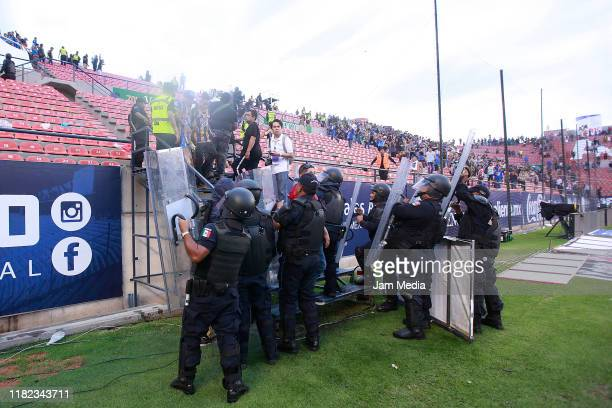 Fans of San Luis and Queretaro started a fight between them in the stands during the 14th round match between Atletico San Luis and Queretaro as part...