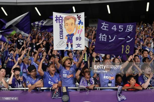 Fans of Sanfrecce Hiroshima cheer after the JLeague J1 match between FC Tokyo and Sanfrecce Hiroshima at Ajinomoto Stadium on August 17 2019 in Chofu...