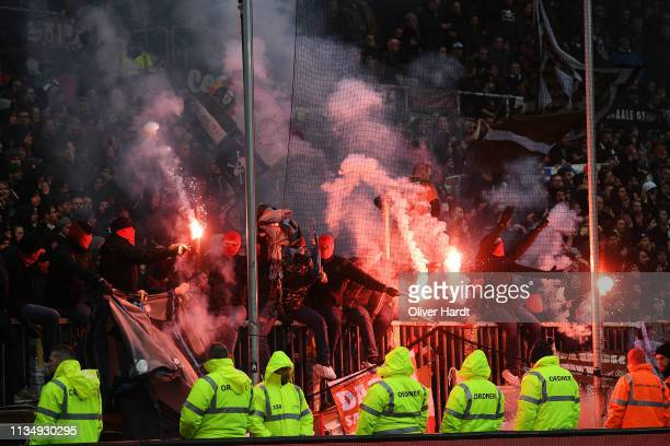 Fans of Sankt Pauli with pyrotechnics during the Second Bundesliga match between FC St Pauli and Hamburger SV at Millerntor Stadium on March 10 2019...