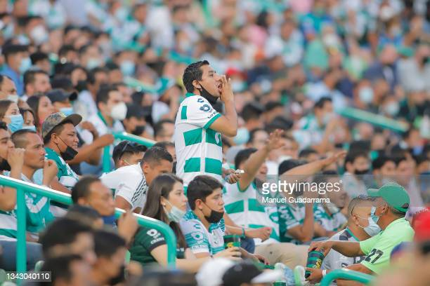 Fans of Santos shout during the 10th round match between Santos Laguna and Monterey as part of the Torneo Grita Mexico A21 Liga MX at Corona Stadium...