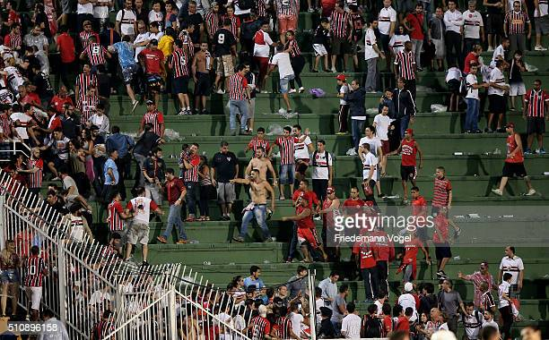Fans of Sao Paulo fights during a match between Sao Paulo v The Strongest as part of Group 1 of Copa Bridgestone Libertadores at Pacaembu Stadium on...