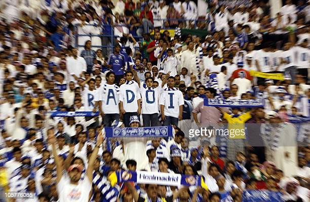 Fans of Saudi AlHilal cheer for their team during their AFC Champions League semifinal football match against Iran's Zobahan in Riyadh on October 20...