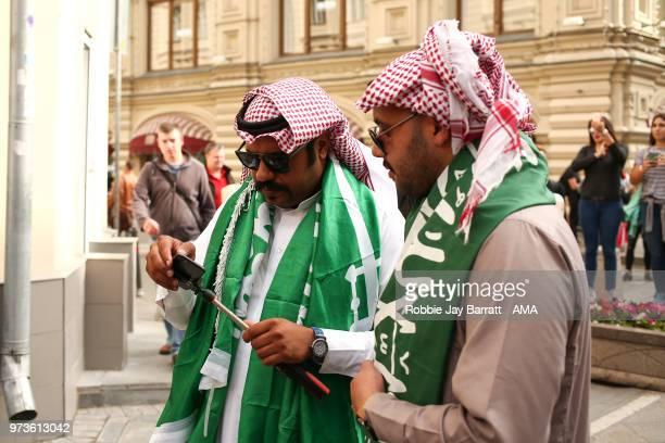 Fans of Saudi Arabia congregate on Nikolskaya Street a pedestrian street in KitayGorod in Moscow on June 13 2018 in Moscow Russia
