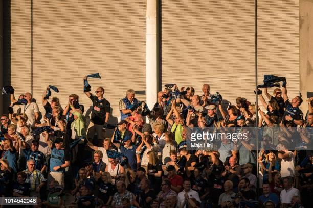 Fans of SC Paderborn celebrate during the Second Bundesliga match between SC Paderborn 07 and SSV Jahn Regensburg at Benteler Arena on August 10,...