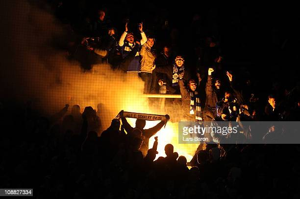 Fans of Schalke are seen during the Bundesliga match between Borussia Dortmund and FC Schalke 04 at Signal Iduna Park on February 4 2011 in Dortmund...