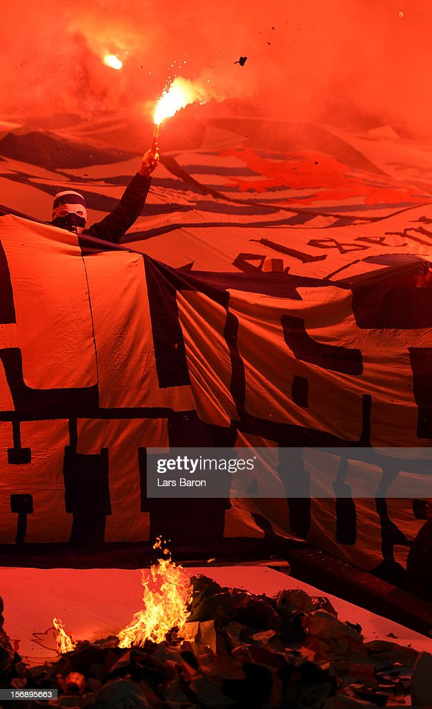 Fans of Schalke burn flares during the Bundesliga match between FC Schalke 04 and Eintracht Frankfurt at Veltins-Arena on November 24, 2012 in Gelsenkirchen, Germany.