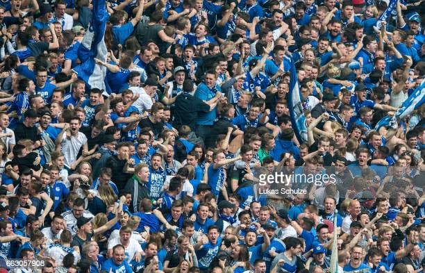 Fans of Schalke celebrate their teams first goal during the Bundesliga match between FC Schalke 04 and Borussia Dortmund at VeltinsArena on April 1...