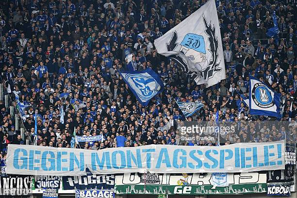 Fans of Schalke protest against monday matches during the Bundesliga match between Hannover 96 and FC Schalke 04 at the HDI Arena on April 30 2016 in...