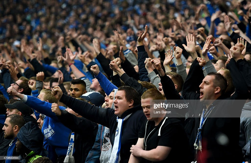 Fans of Schalke react during the Bundesliga match between FC Schalke 04 and SC Paderborn at Veltins Arena on May 16, 2015 in Gelsenkirchen, Germany.