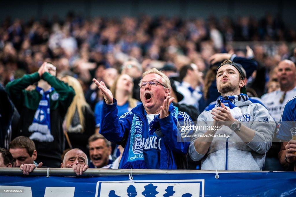 Fans of Schalke react during the Bundesliga match between FC Schalke 04 and Borussia Moenchengladbach at Veltins-Arena on April 28, 2018 in Gelsenkirchen, Germany.