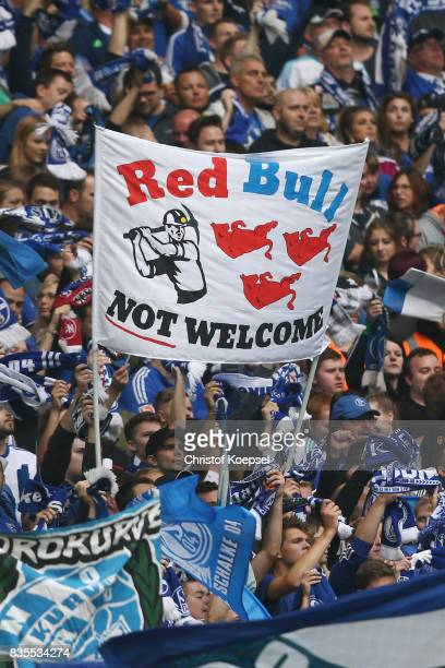 Fans of Schalke show their disrespect over Red Bull and RB Leipzig during the Bundesliga match between FC Schalke 04 and RB Leipzig at VeltinsArena...