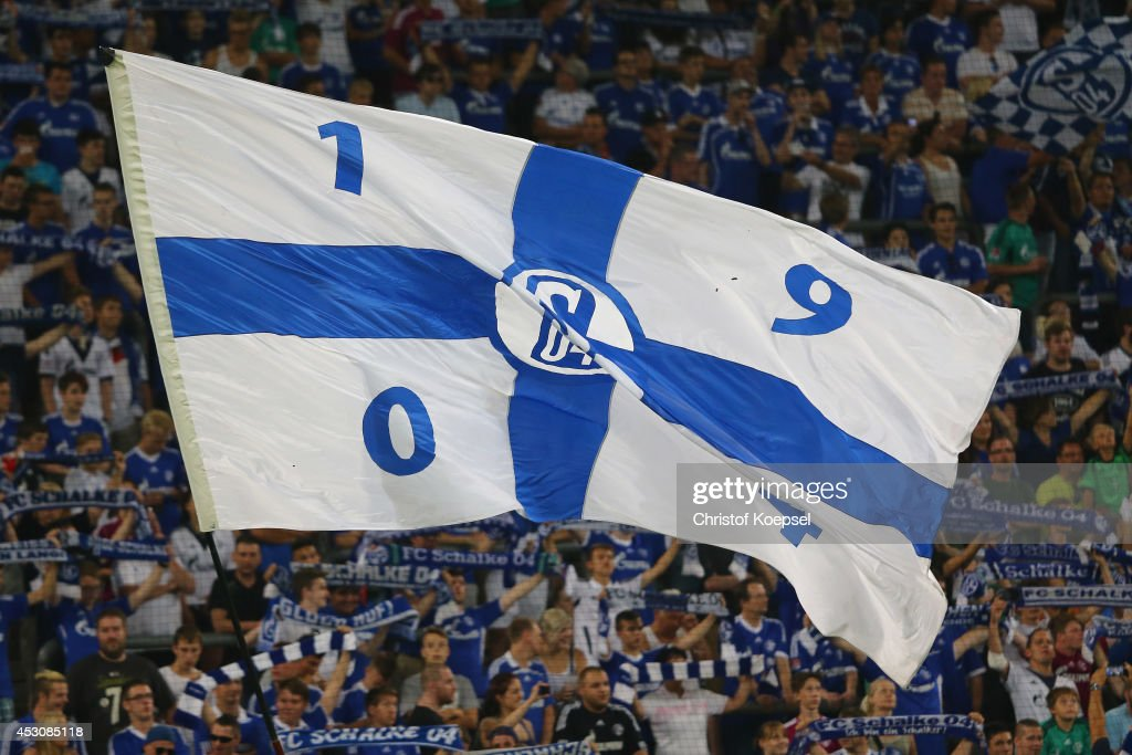Fans of Schalke wave a flag during the match between FC Schalke 04 and West Ham United as part of the Schalke 04 Cup Day at Veltins-Arena on August 2, 2014 in Gelsenkirchen, Germany.