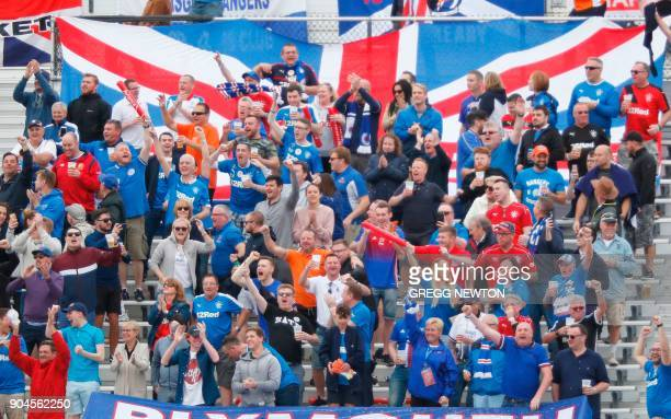 Fans of Scottish club Rangers FC cheer their team after a second half goal against Brazilian club Corinthiansl during their Florida Cup soccer game...