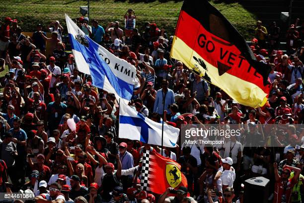 Fans of Sebastian Vettel of Germany and Ferrari celebrate on the circuit during the Formula One Grand Prix of Hungary at Hungaroring on July 30 2017...