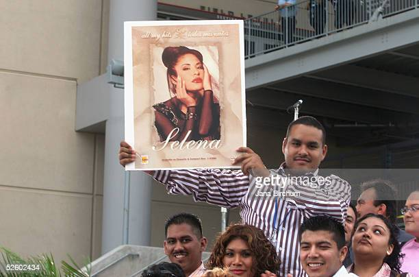 Fans of Selena and Latin music wait at the Selena Vive tribute concert April 7 Reliant Stadium Houston Texas Many of the stars of Latin music and...