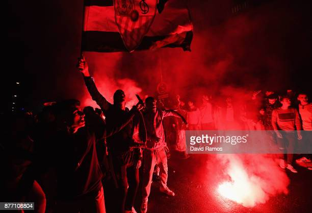Fans of Sevilla FC make their way to the stadium prior to the UEFA Champions League group E match between Sevilla FC and Liverpool FC at Estadio...