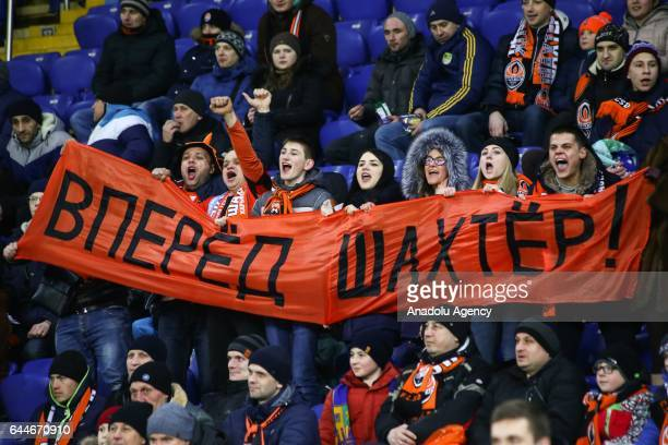 Fans of Shakhtar Donetsk cheer up during the UEFA Europa League Round of 32 second leg match between Shakhtar Donetsk and Celta Vigo at Metalist...