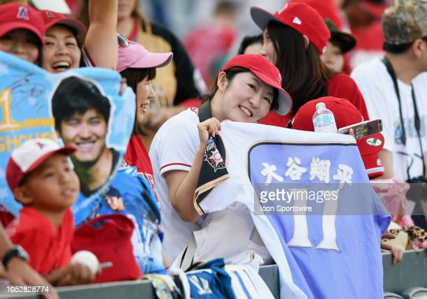 Fans of Shohei Ohtani in the stands on the third base side before the start off a game between the Seattle Mariners and the Los Angeles Angels of...