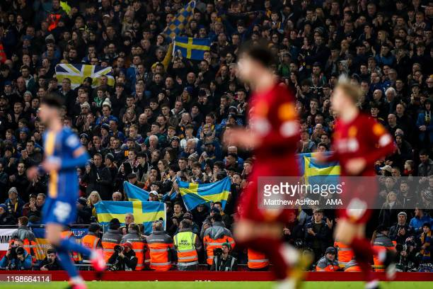Fans of Shrewsbury Town pay tribute to late fan Kenneth Lovgren during the FA Cup Fourth Round Replay match between Liverpool and Shrewsbury at...