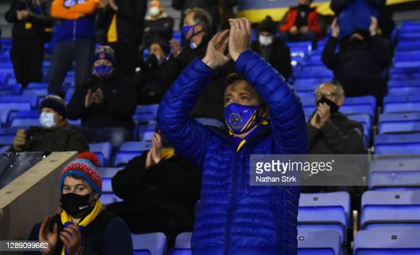 Fans of Shrewsbury Town shows his support from inside of the stadium wearing fans masks during the Sky Bet League One match between Shrewsbury Town...