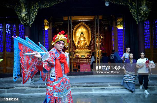 A fans of Sichuan Opera wearing costumes poses at Daci Temple on July 3 2019 in Chengdu Sichuan Province of China