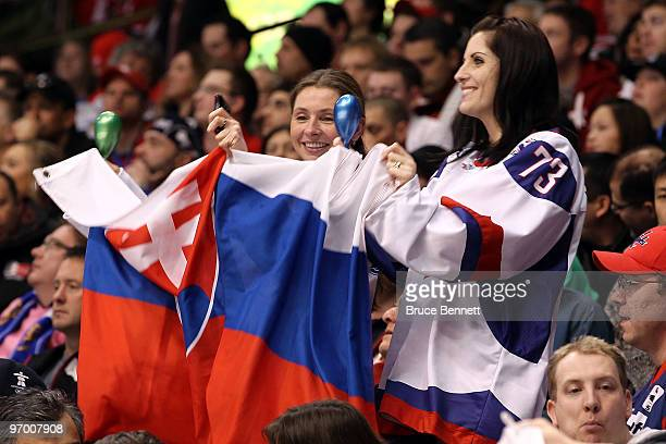 Fans of Slovakia wave a flag during the ice hockey Men's Qualification Playoff game between Norway and Slovakia on day 12 of the Vancouver 2010...