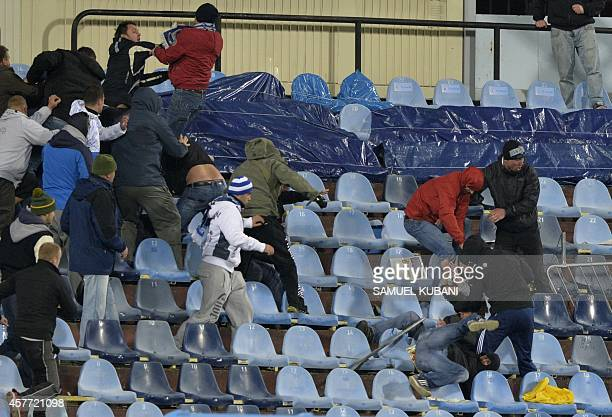 Fans of Slovan Bratislava and Sparta Praha fight during the UEFA Europa League Group I football match SK Slovan Bratislava vs AC Sparta Praha on...
