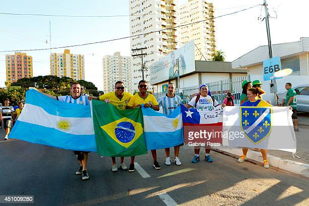 Fans of soccer pose for a photo as they stretch flags of Argentina Brazil Chile and Bosnia prior the match between Nigeria and BosniaHerzegovina...