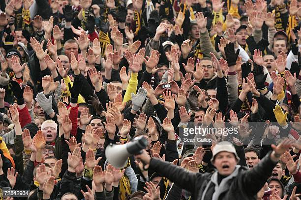 Fans of soccer team Dynamo Dresden cheer their team and taunt rival fans during Dynamo's 3rd Liga match against FC Union Berlin November 4 2006 in...