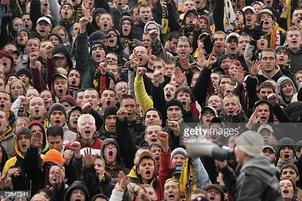Fans of soccer team Dynamo Dresden cheer their team and taunt rival fans during Dynamo's 3rd Liga match against FC Union Berlin November 4, 2006 in...