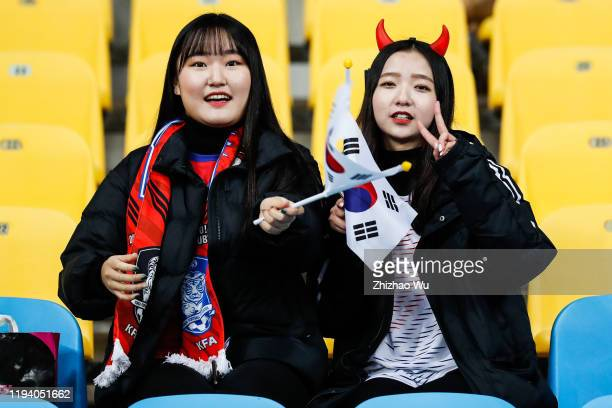 Fans of South Korea cheer during the EAFF E-1 Football Championship match between South Korea and China at Busan Asiad Main Stadium on December 15,...