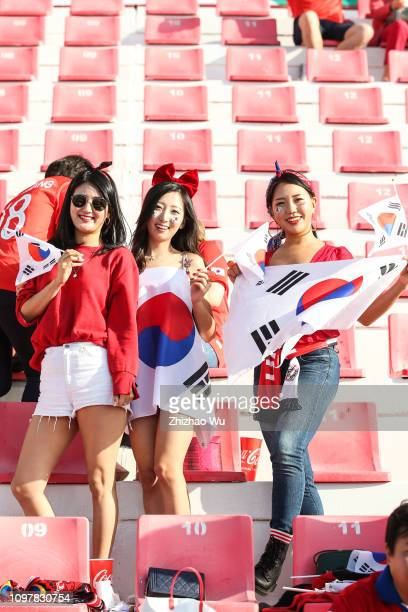 Fans of South Korea enjoy the atmosphere during the AFC Asian Cup round of 16 match between South Korea and Bahrain at Rashid Stadium on January 22...