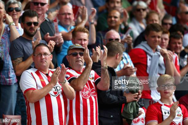 Fans of Southampton cheer on their team during the Premier League match between Southampton and Swansea City at St Mary's Stadium on August 12 2017...